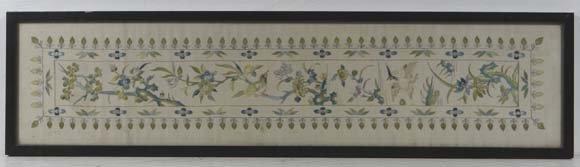 An Oriental silk work framed Kimono? Cuff depicting two