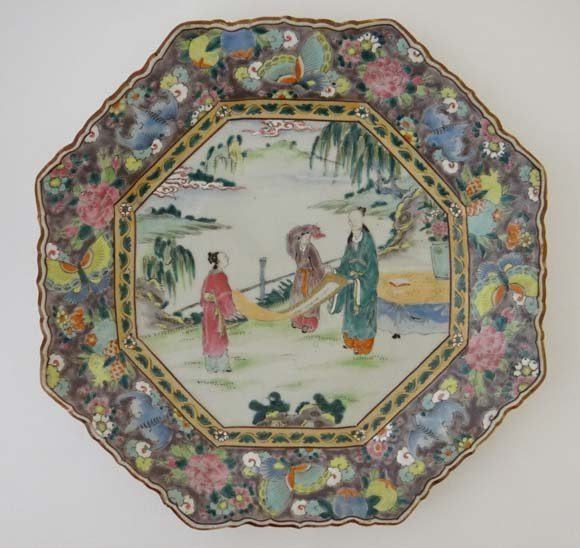 A large Oriental Charger of octagonal shape decorated i