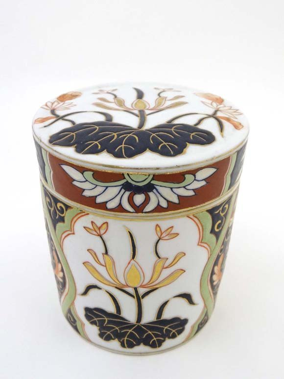 A cylindrical Chinese container and cover decorated in