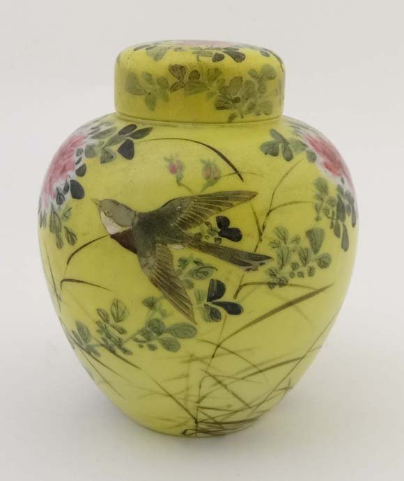 A Chinese Ginger jar and cover painted with peony flowe