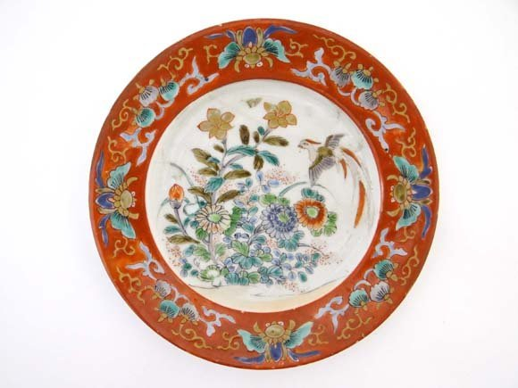 An Oriental plate decorated with iron red enamels palet
