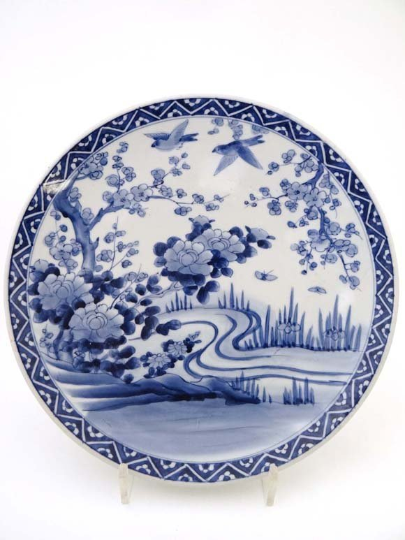 A blue and white Chinese charger, painted with a river