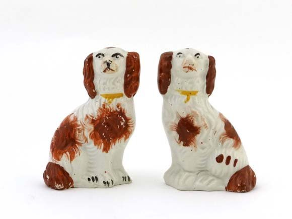 A pair of Victorian Staffordshire pottery spaniels deco
