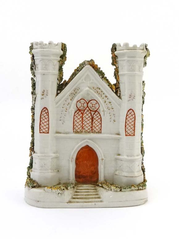 A Victorian Staffordshire model of a church, having 2 t