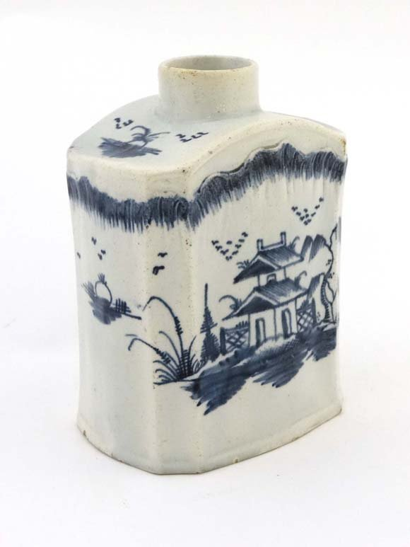 An 18thC pearlware blue and white tea caddy painted wit