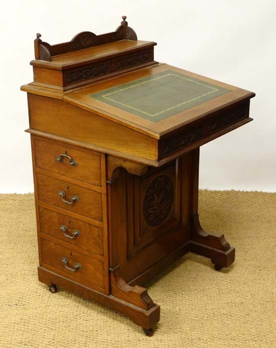 A late Victorian walnut Davenport with stationary