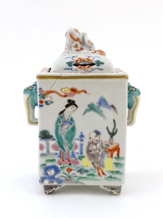 An 18thC Chinese porcelain incense burner and cover,