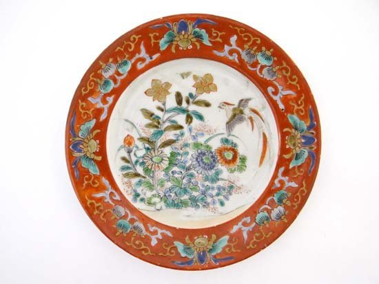 An Oriental plate decorated with iron red enamels
