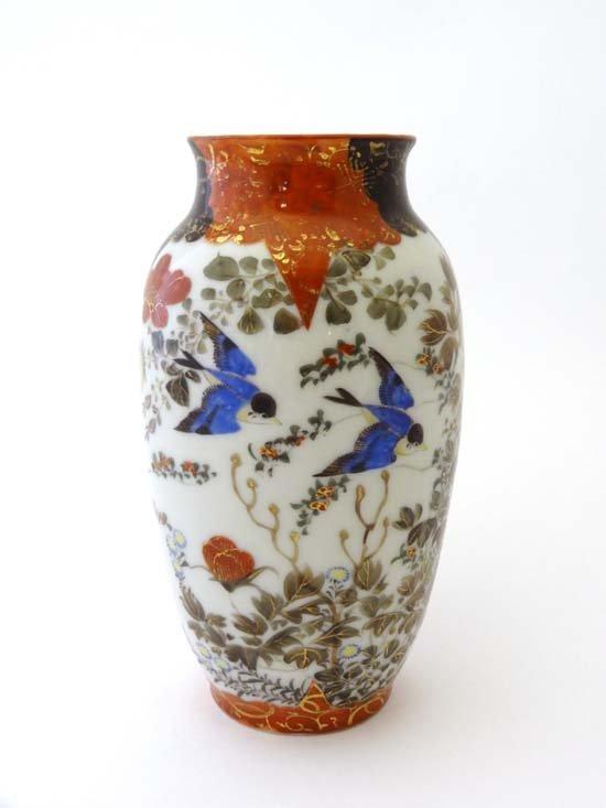 Kutani : A Japanese hand painted vase signed under with