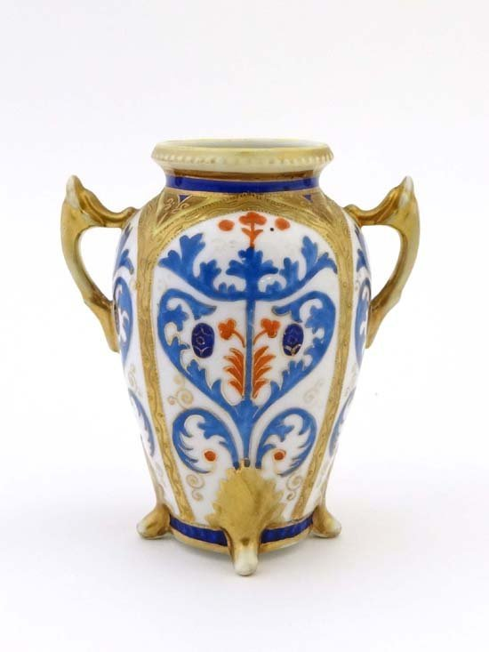 A two handled four footed Noritake vase handpainted in