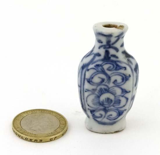 A Chinese porcelain medicine bottle of baluster shape