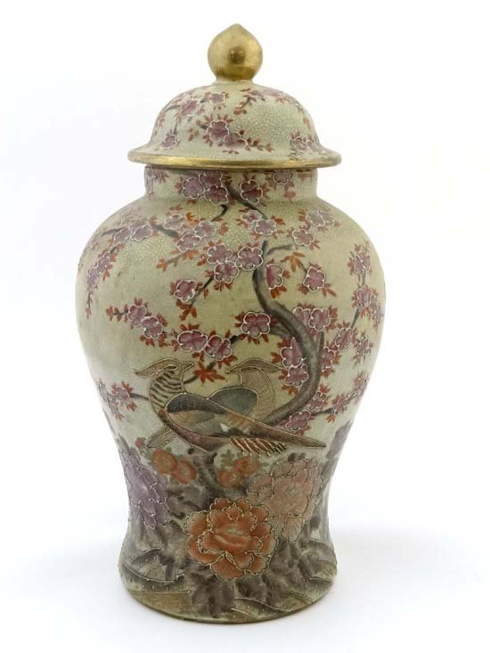 A 20thC Chinese jar and cover, the jar of baluster