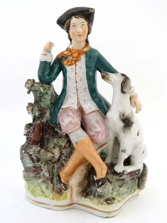 A Victorian Staffordshire figure of a male figure