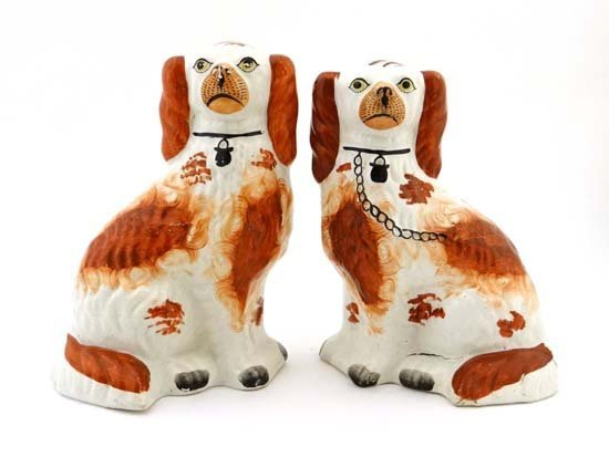 A pair of Victorian Staffordshire dogs decorated with