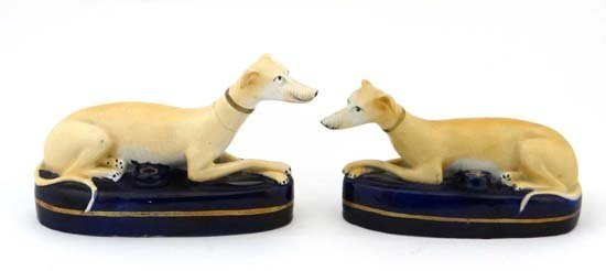 A pair of Victorian Staffordshire pottery ink wells in
