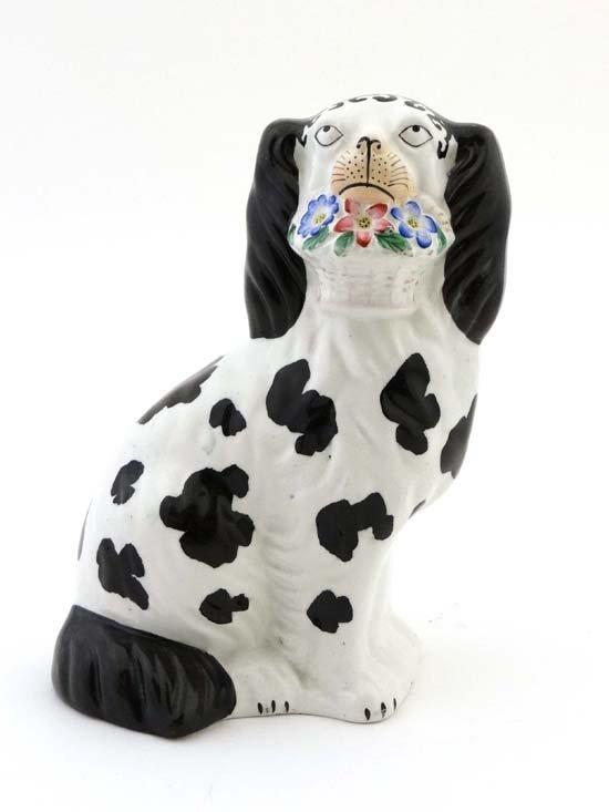 A Victorian Staffordshire figure of a Disraeli Dog, the