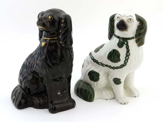 A Victorian Staffordshire spaniel glazed in green and
