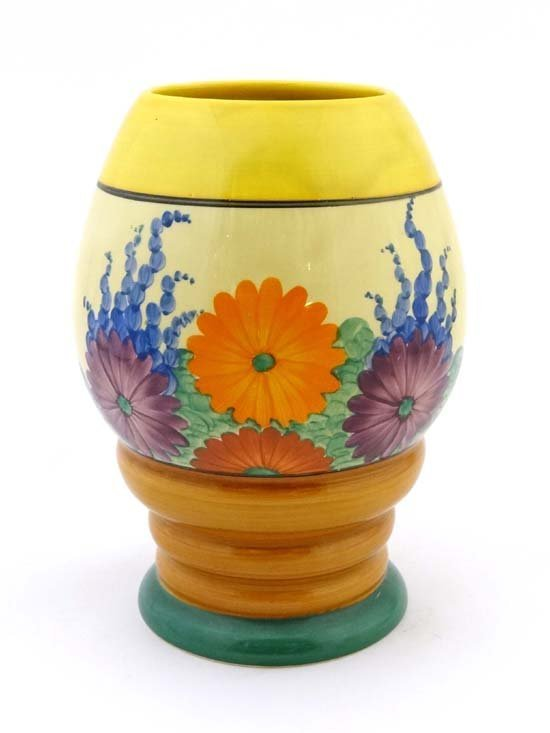 A Clarice Cliff Bizarre vase, shape 362, hand painted