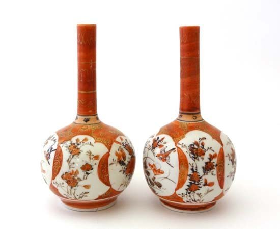 Kutani : A pair of Japanese hand painted onion vases,