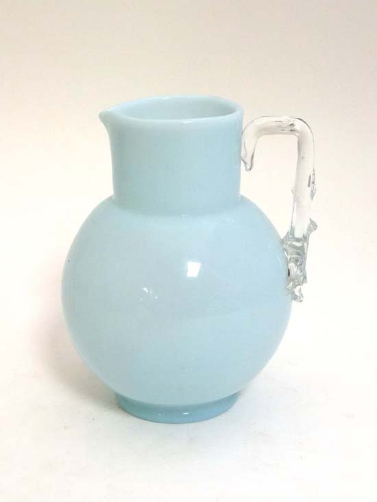A c.1870 rare blue opalascent glass jug  with clear