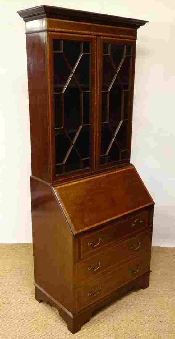 An Edwardian mahogany bureau bookcase desk with