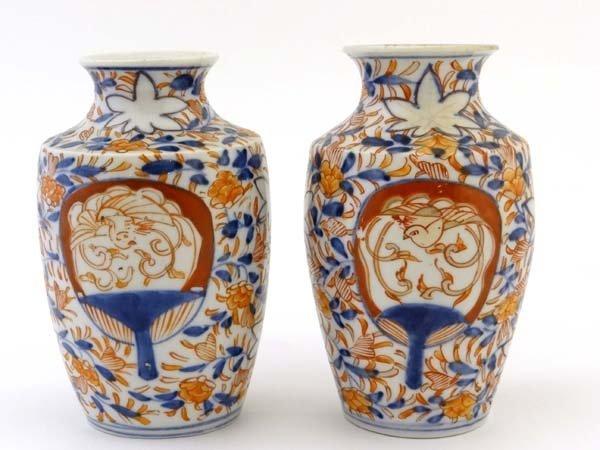 A pair of Japanese Imari vases having tapered shaped