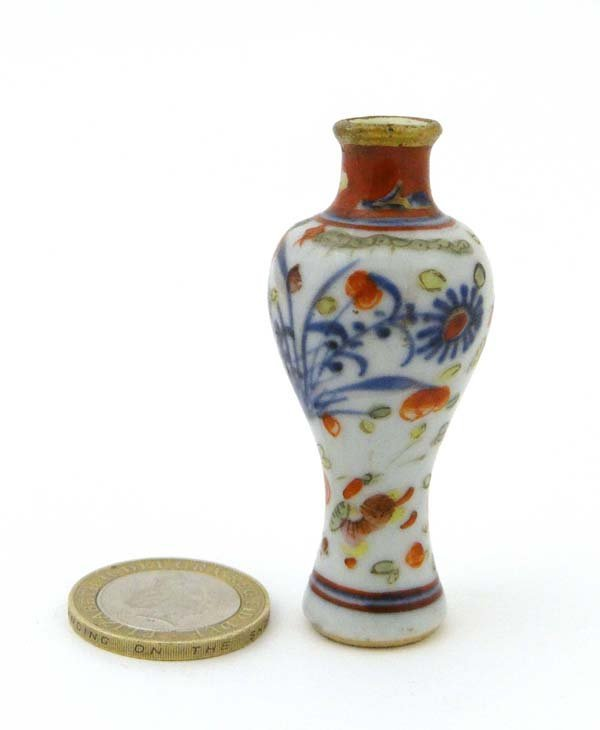 A miniature Oriental vase of baluster shape decorated