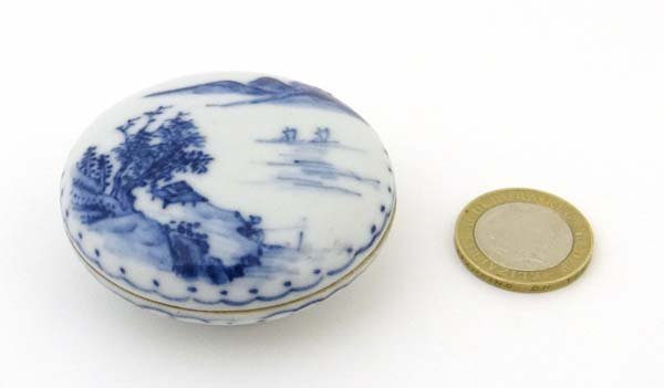 A Chinese porcelain circular lidded box painted in blue