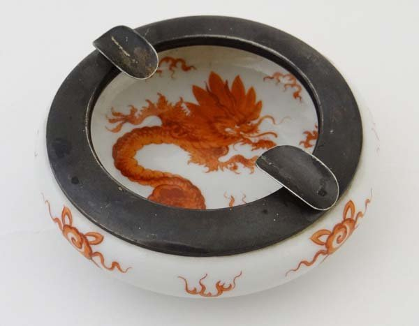 A Meissen porcelain dish painted in iron red with