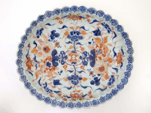 An oriental lobed oval dish, blue, white and rust