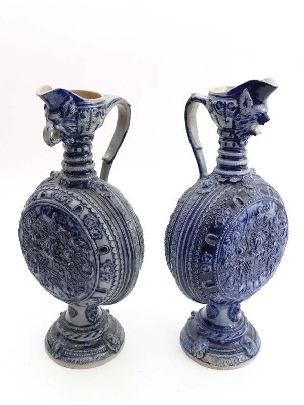 A pair of German grey salt glaze moonflasks with cobalt
