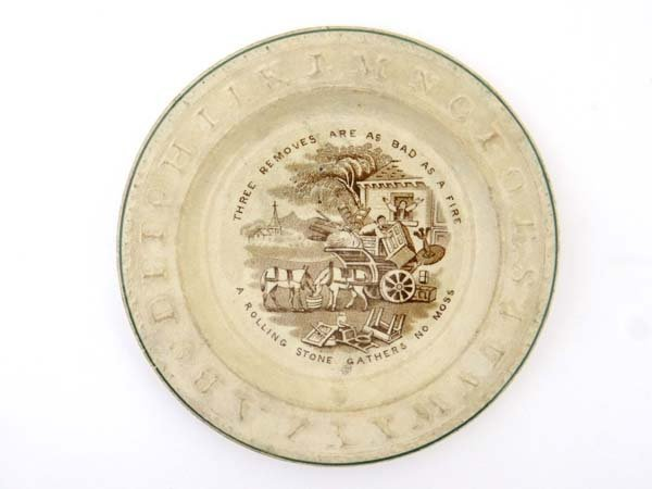 A Victorian motto plate with moulded alphabet border,