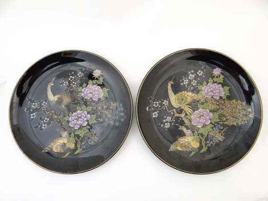 A pair of Japanese Shibata porcelain plates decorated