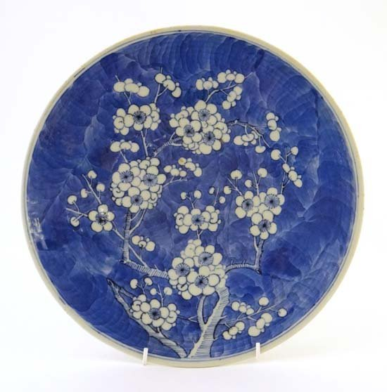An Oriental large circular plate decorated with prunus