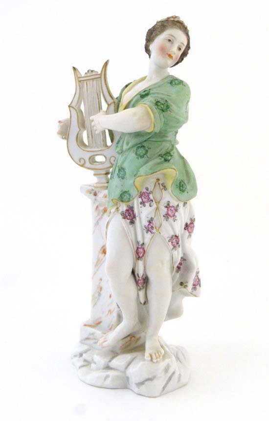 A Meissen figurine depicting a classical female with a