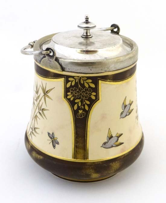 A c1860 MacIntyre biscuit barrel decorated with panels