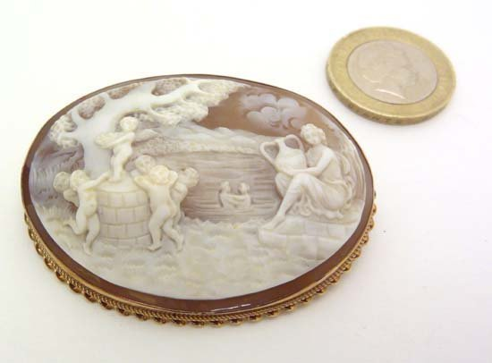 A large carved cameo depicting a classical scene with