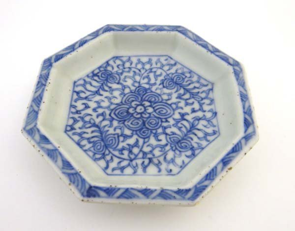 A Chinese octagonal shaped dish decorated in blue with