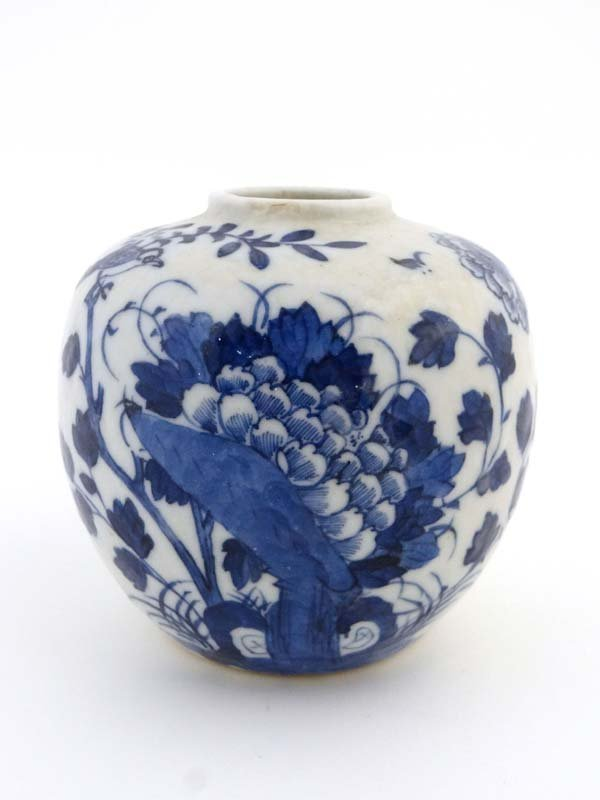 An Oriental blue and white globular shaped ginger jar