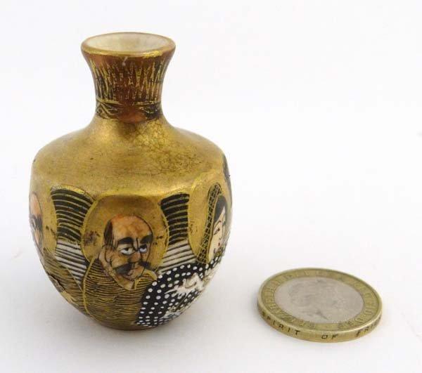 A Japanese Satsuma miniature vase having gilded sloped