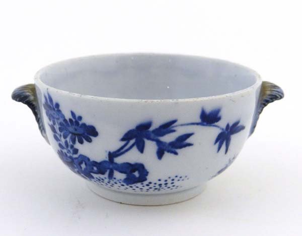 A 19thC pearlware tea bowl painted in blue with