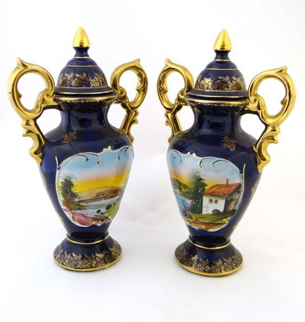 A pair of baluster shaped covered vases having tall