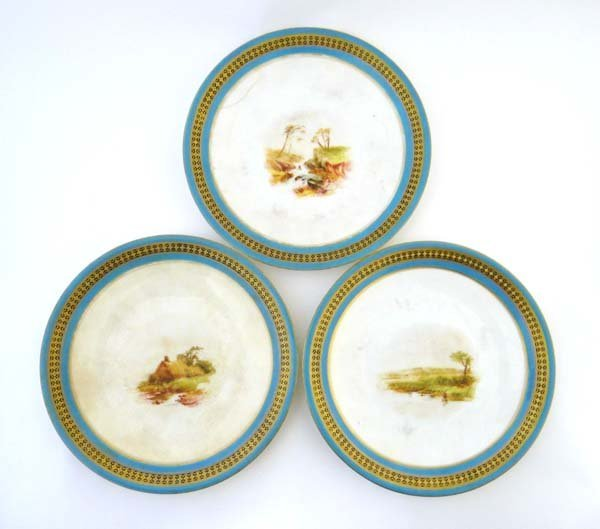 A set of Royal Worcester plates, hand painted vignette
