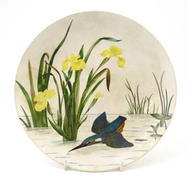 A beautifully hand painted Minton circular plate, a