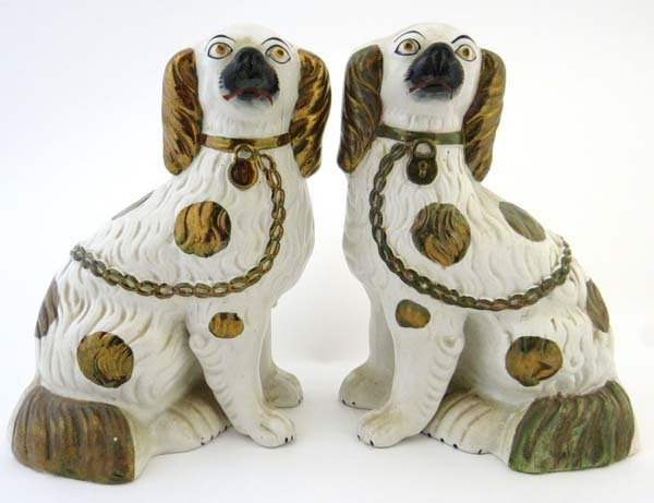 A pair of Victorian Staffordshire spaniels decorated