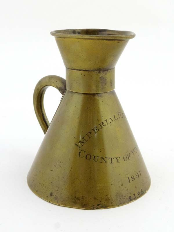 A 19thC brass Customs Imperial Half Pint Measure,