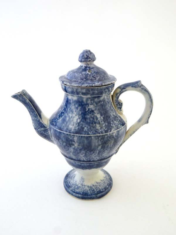 A 19thC blue sponge ware teapot and cover, the shaped