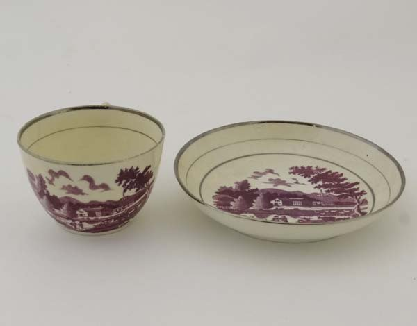 A 19thC cup and saucer, bat printed in puce with a