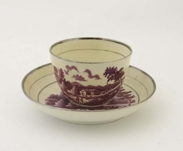 A 19thC cup and saucer, bat printed in puce with a - 2