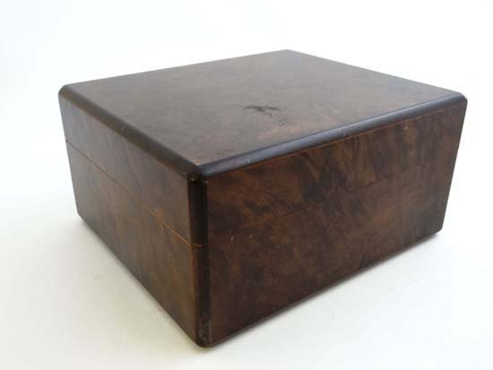 A mid 20thC cigar humidor of burr walnut opening to